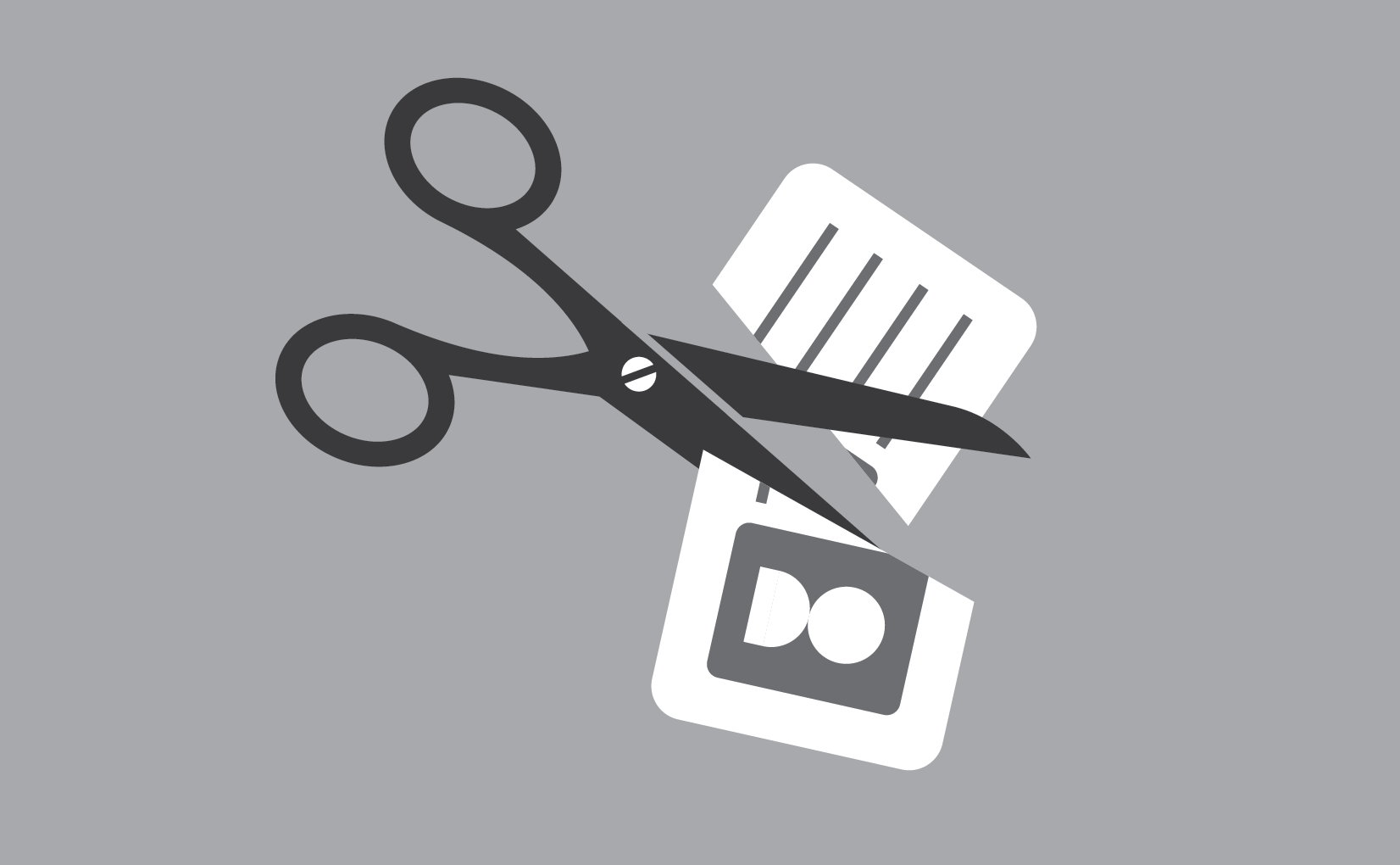 scissors cutting biz card